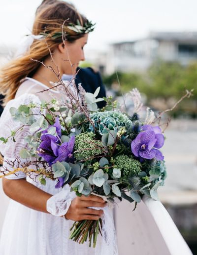 Boho Bride Holding Wedding Bouquet